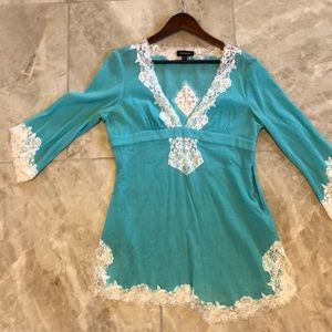 Turquoise Bebe tunic with sexy lace detail.